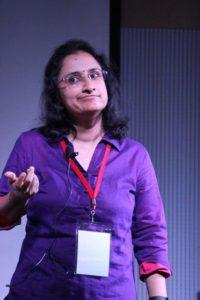 Radhika Nathan speaking at an event